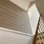 Staircase with acoustical panels from WoodUpp